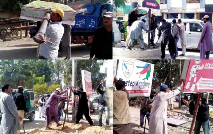 حیدر آباد: بلدیہ کا انسداد تجاوزات عملہ لطیف آباد میں فٹ پاتھوں اور گرین بیلٹس پر لگے بل بورڈز ہٹا رہا ہے