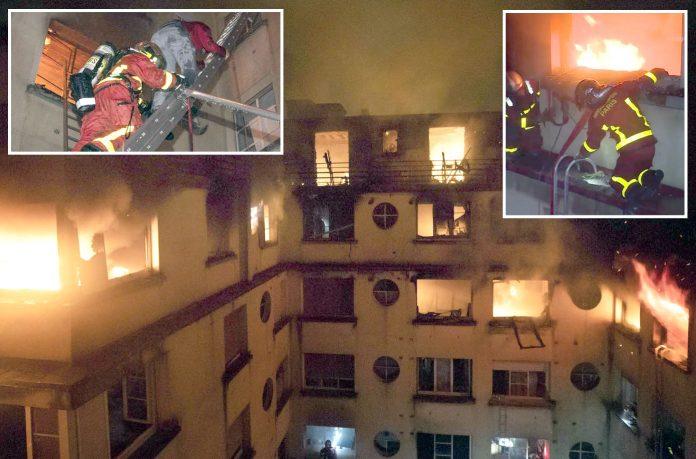 پیرس: فائر بریگیڈ کا عملہ کثیر منزلہ رہایشی عمارت میں لگی آگ پر قابو پانے میں مصروف ہے