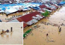 انڈونیشیامیں سیلاب کے بعد آبادی ڈوبی ہوئی ہے چھوٹی تصویر میں ایک شخص ستون کو پکڑ کر بچنے کی کوشش کررہا ہے