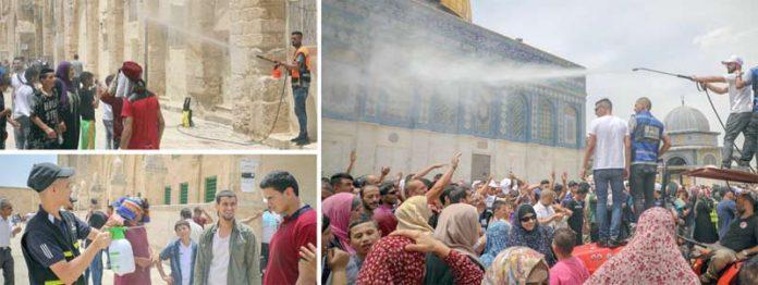 مقبوضہ بیت المقدس: شدید گرمی کے باعث نمازِ جمعہ کی ادائیگی کے لیے مسجد اقصیٰ آنے والوں پر پانی کی پھوار کرکے حدت کا احساس کم کیا جارہا ہے