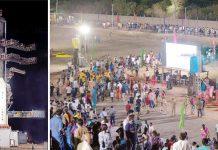 بنگلور: انڈین اسپیس ریسرچ آرگنائزیشن کی رصدگاہ کے قریب صحافی اور شہری تاریخی لمحہ دیکھنے کے لیے جمع ہیں' چندران دوئم مشن مؤخر ہونے کے بعد راکٹ اپنی جگہ کھڑا ہے
