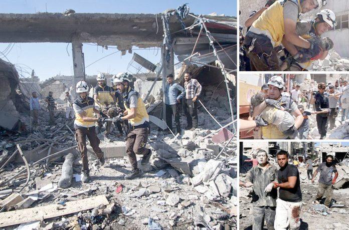 معرۃ النعمان (ادلب): روسی بم باری سے دکانیں تباہ ہوگئی ہیں' امدادی کارکن ملبے سے لاشیں اور زخمی نکال رہے ہیں