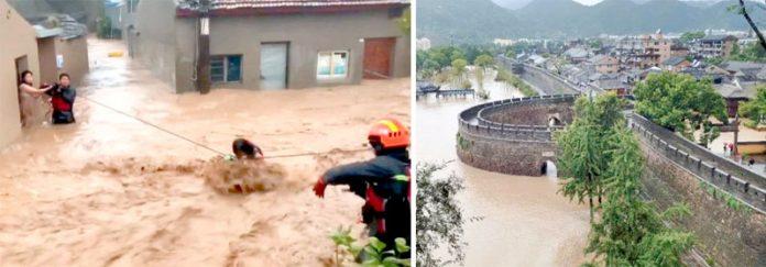 چین: طوفان کے نتیجے میں 1500 سال قدیم قصبہ زیرآب آگیا ہے' امدادی اہل کار سیلاب میں پھنسے شہریوں کو رسی کی مدد سے نکال رہے ہیں