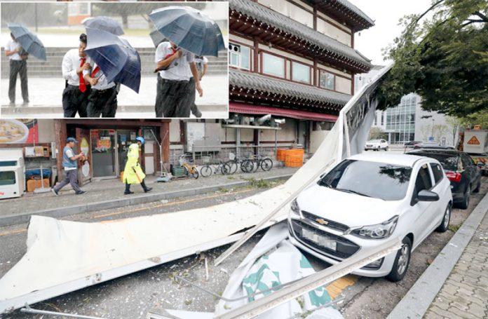 جنوبی کوریا: آندھی کے باعث سائن بورڈ گاڑی پر آگرا ہے' شہری طوفانی بارش سے بچنے کی کوشش کررہے ہیں