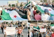ادلب: خان شیخون قصبے کے عوام بشارالاسد حکومت اور روسی فوج کی انسانیت سوز کارروائیوں کے خلاف مظاہرہ کررہے ہیں