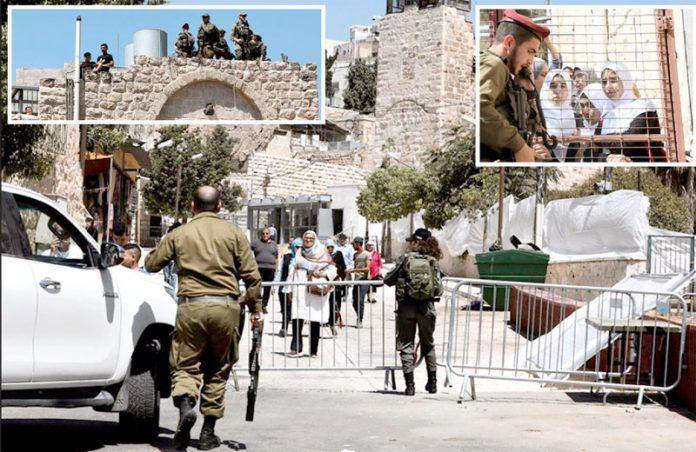 الخلیلـ: صہیونی وزیراعظم بنیامین نیتن یاہو کی آمد پر حرم ابراہیمی کو سیل کرنے کے ساتھ شہر کو فوجی چھاؤنی میں تبدیل کردیا گیا ہے