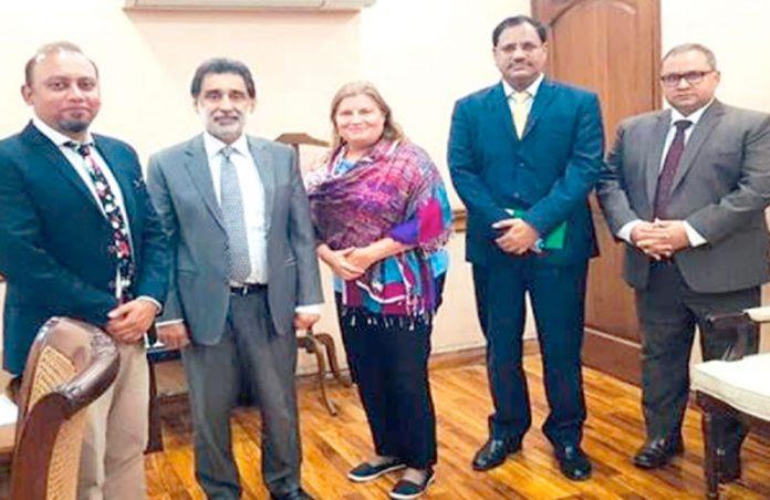 یو ایس ایڈ کے وفد کا نیشنل بینک آف پاکستان کے دورے کے موقع پر بینک عہدیداران کے ہمراہ گروپ فوٹو