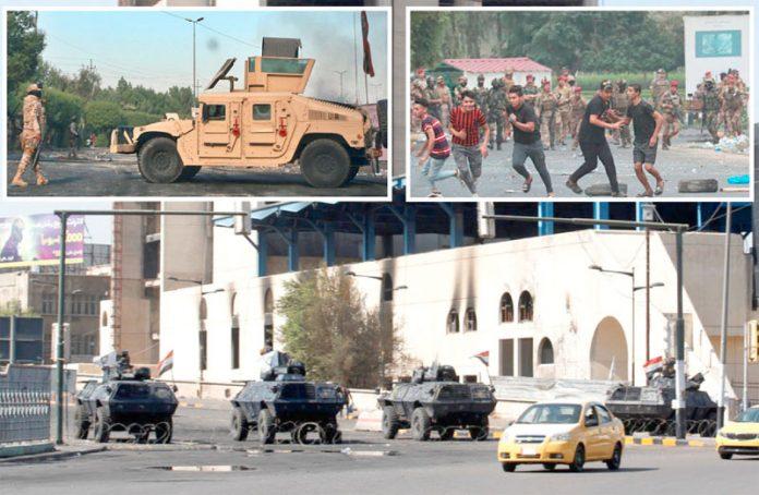 بغداد: اہم سرکاری عمارتوں کی جانب جانے والی سڑکوں کو بکتربند گاڑیاں کھڑی کرکے بند کردیا گیا ہے' نوجوان فوج کی گولیوں سے بچنے کی کوشش کررہے ہیں